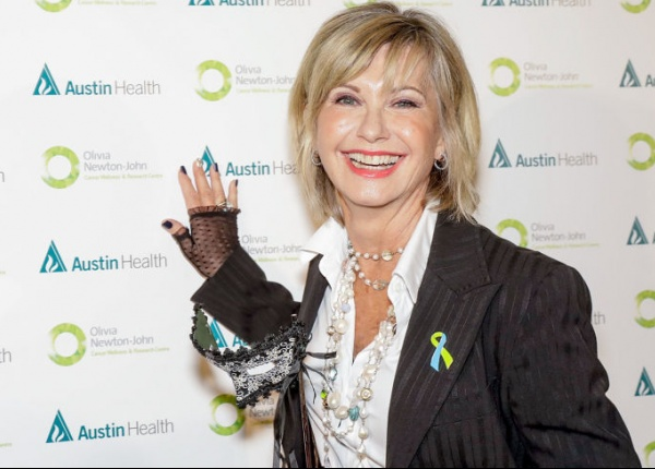 Оливия Нютън-Джон казва, че нейната нова диагноза я оставила неспособна да ходи